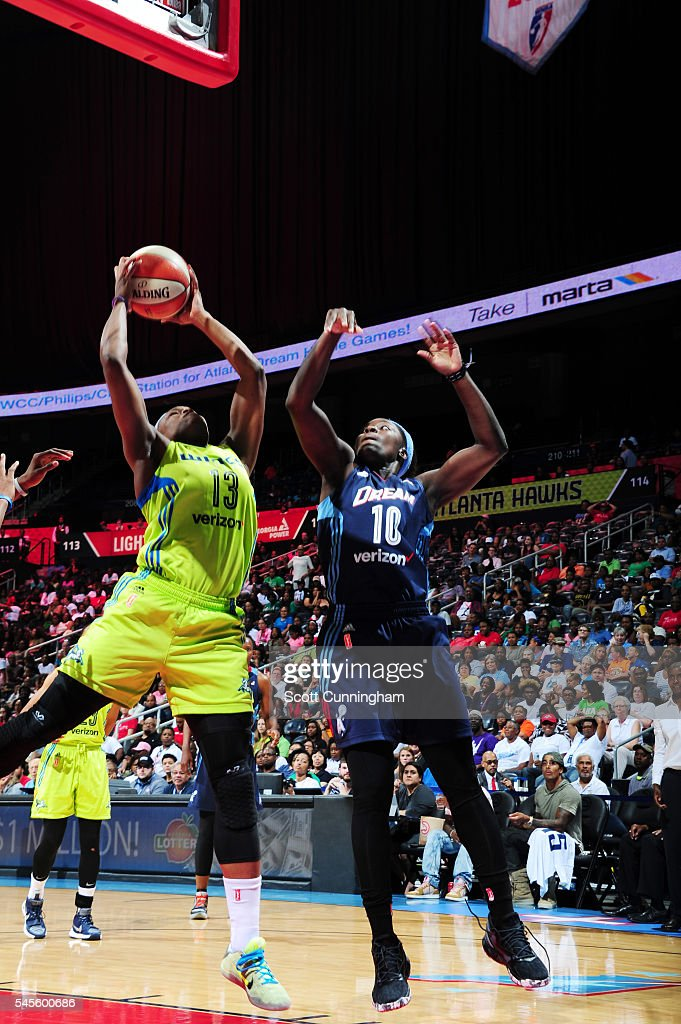 Karima Christmas of the Dallas Wings shoots the ball against Matee Ajavon of the Atlanta Dream on July 8 2016 at Philips Arena in Atlanta Georgia...