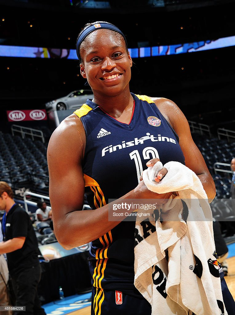 Karima Christmas #13 of the Indiana Fever celebrates after the game against the Atlanta Dream on July 1, 2014 at Philips Arena in Atlanta, Georgia.