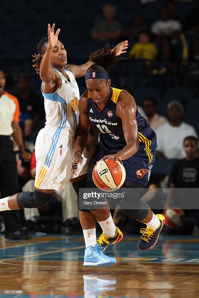 Karima Christmas #13 of the Indiana Fever drives against the Chicago Sky on July 22, 2014 at the Allstate Arena in Rosemont, Illinois.