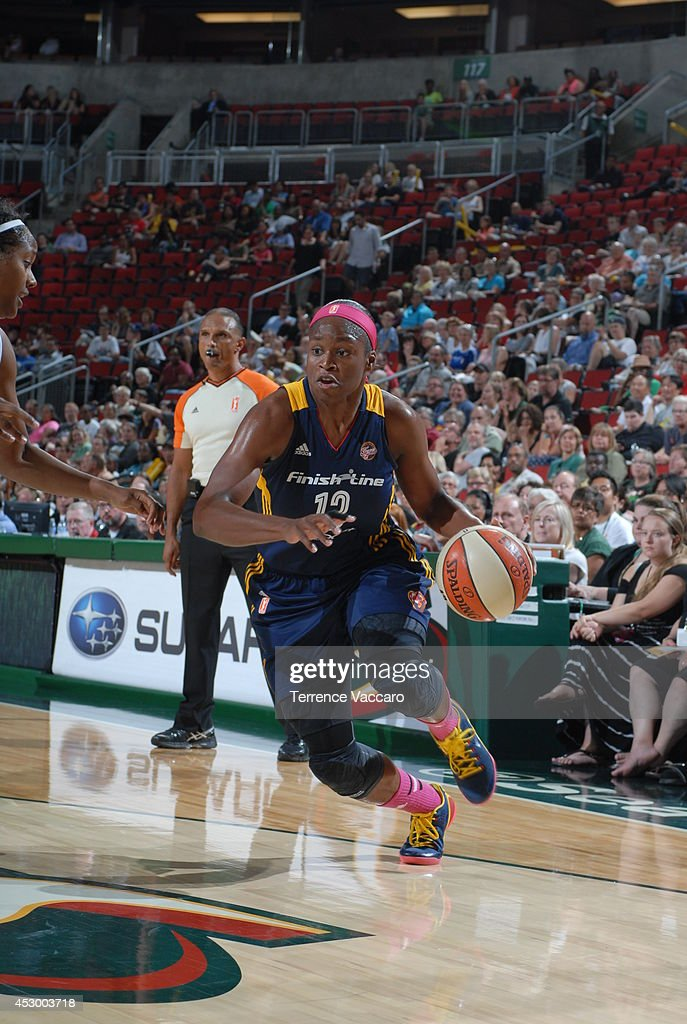Karima Christmas #13 of the Indiana Fever drives to the basket against the Seattle Storm on July 31,2014 at Key Arena in Seattle, Washington.