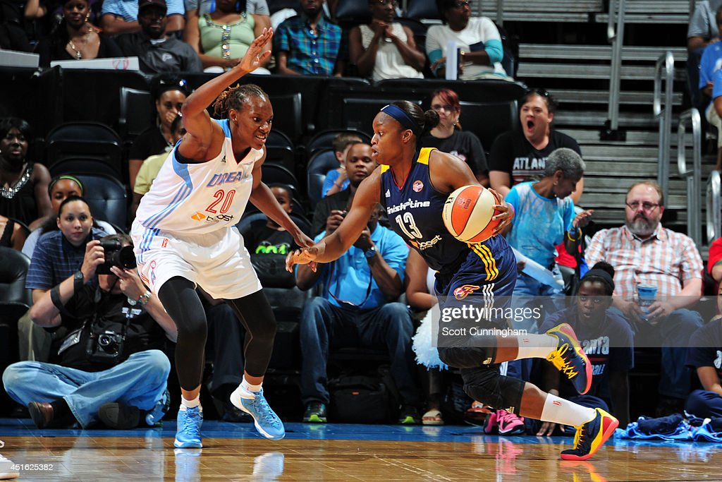 Karima Christmas #13 of the Indiana Fever handles the ball against the Atlanta Dream on July 1, 2014 at Philips Arena in Atlanta, Georgia.
