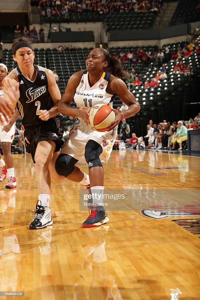 Karima Christmas #11 of the Indiana Fever moves on Julie Wojta #2 of the San Antonio Silver Stars on May 13, 2013 at Bankers Life Fieldhouse in Indianapolis, Indiana.