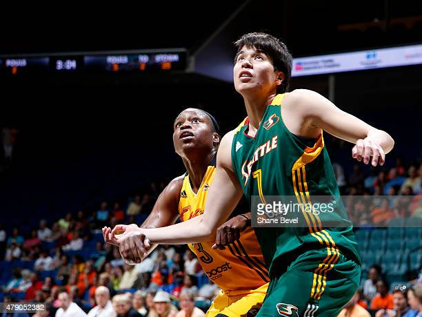 Karima Christmas of the Tulsa Shock and Ramu Tokashiki of the Seattle Storm battle for position on June 28 2015 at the BOK Center in Tulsa Oklahoma...