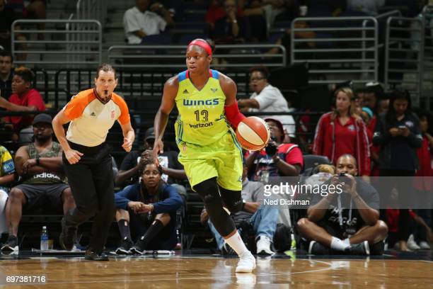 Karima ChristmasKelly of the Dallas Wings handles the ball during a game against the Washington Mystics on June 18 2017 at the Verizon Center in...