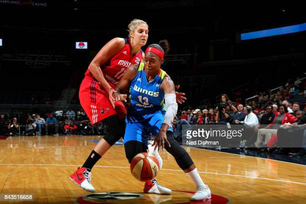 Karima ChristmasKelly of the Dallas Wings handles the ball during the game against the Washington Mystics during Round One of the 2017 WNBA Playoffs...