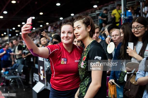 Karin Adamkova of Czech Republic makes a selfie with Ding Ning of China after loosing against her during Women Single 2 Round at Table Tennis World...