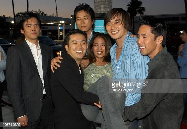 Karin Anna Cheung is lifted up by her costars and director Director Justin Lin Roger Fan and Parry Shen Also pictured are costars Sung Kang and John...