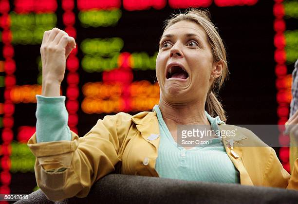 Karin Bratta a clerk at the Chicago Mercantile Exchange signals prices in the Eurodollar Options pit following the announcement that the Federal...