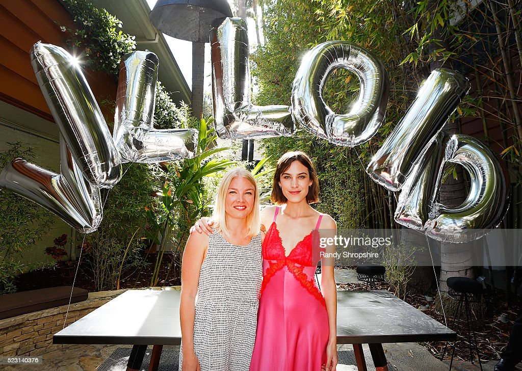 Karin Kallman (L) and Alexa Chung attend the Villoid garden tea party hosted by Alexa Chung at the Hollywood Roosevelt Hotel on April 21, 2016 in Hollywood, California.