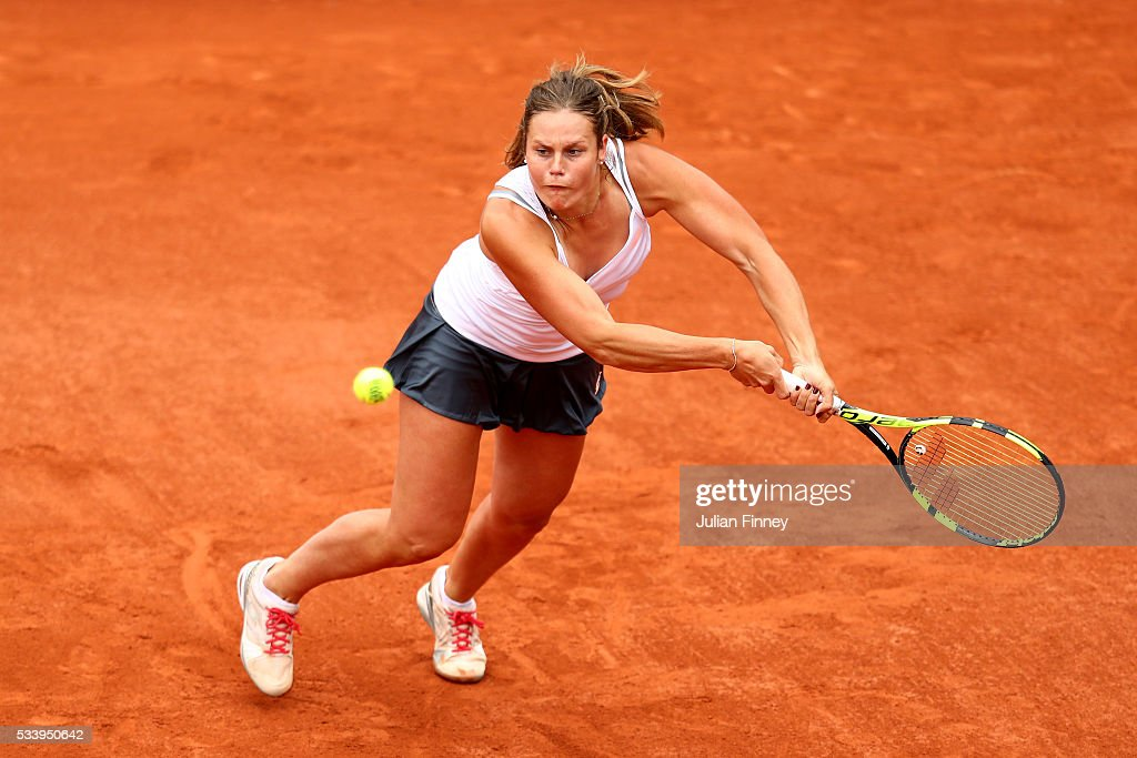 Karin Knapp of Italy hits a backhand during the Ladies Singles first round match against Victoria Azarenka of Belarus on day three of the 2016 French Open at Roland Garros on May 24, 2016 in Paris, France.