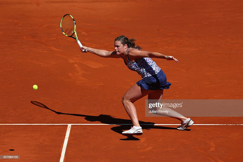 <a gi-track='captionPersonalityLinkClicked' href=/galleries/search?phrase=Karin+Knapp&family=editorial&specificpeople=4288619 ng-click='$event.stopPropagation()'>Karin Knapp</a> of Italy in action against Simona Halep of Romania during day four of the Mutua Madrid Open tennis tournament at the Caja Magica on May 03, 2016 in Madrid, Spain.