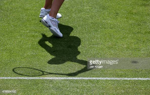 Karin Knapp of Italy in action against Yanina Wickmayer of Belgium in her first round match during day one of the WTA Aegon Open Nottingham at...