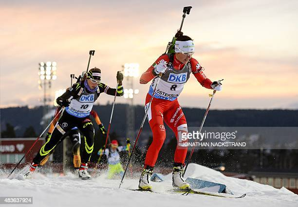 Karin Oberhofer of Italy and Enora Latuilliere of France compete during the women's 10 km pursuit race of the Biathlon World Cup in Ostersund on...