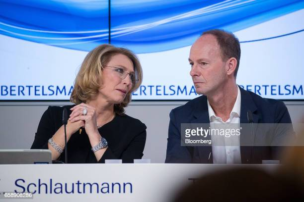 Karin Schlautmann head of corporate communications at Bertelsmann SE left speaks to Thomas Rabe chief executive officer of Bertelsmann SE during a...