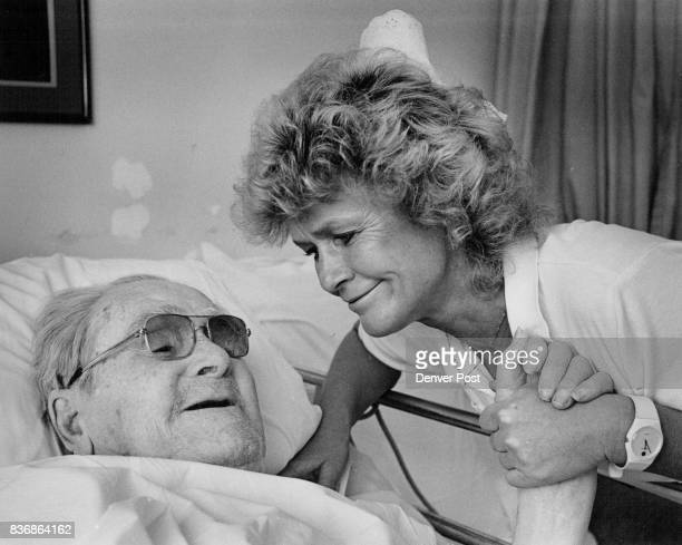 Karin Yung a nurse at hospice of St John's with one of her patients 89 yr old Gordon Shipley of Denver He calls her 'Blondie' Credit Denver Post