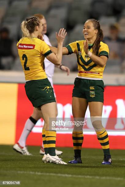 Karina Brown of the Jillaroos congratulates Vanessa Foliaki of the Jillaroos after she scored a try during the women's ANZAC Test match between the...