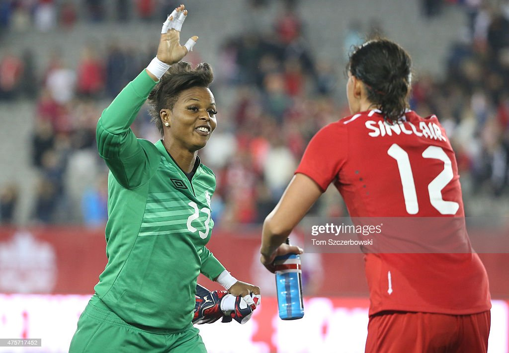 Karina LeBlanc #23 of Canada celebrates their victory with Christine Sinclair #12 against England during their Women's International Friendly match on May 29, 2015 at Tim Hortons Field in Hamilton, Ontario, Canada.