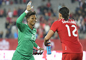 Karina LeBlanc of Canada celebrates their victory with Christine Sinclair against England during their Women's International Friendly match on May 29...