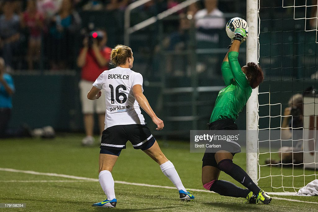 Karina LeBlanc #1 stretches to stop a Western New York Flash shot at the Portland Thorns FC goal as teammate Rachel Buehler #16 watches in the National Women's Soccer League Championship at Sahlen's Stadium August 31, 2013 in Rochester, New York.