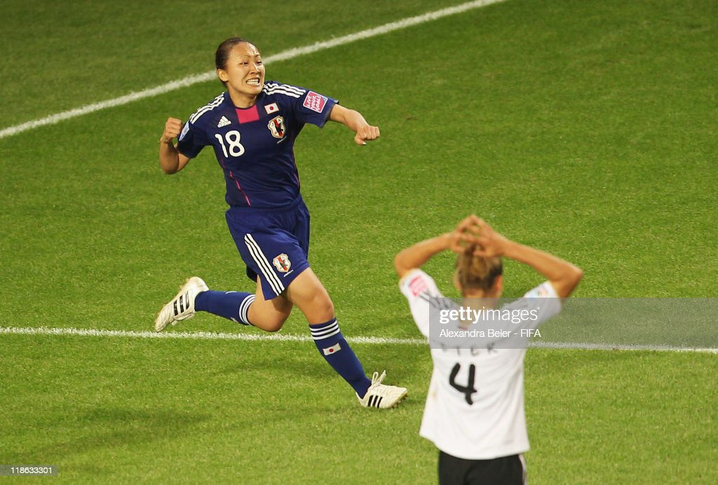 Karina Maruyama (L) of Japan celebrates her first goal as Babett Peter of Germany reacts during the FIFA Women's World Cup quarter finals match between Germany and Japan on July 9, 2011 in Wolfsburg, Germany.
