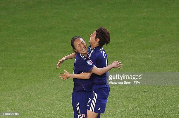 Karina Maruyama of Japan celebrates her first goal with her teammate Yukari Kinga during the FIFA Women's World Cup quarter finals match between...
