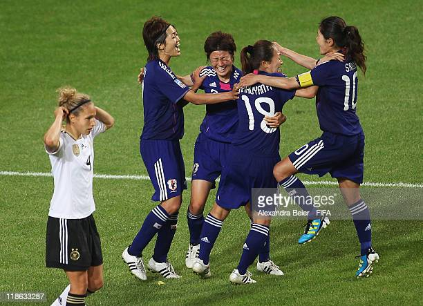 Karina Maruyama of Japan celebrates her first goal with her teammates as Babett Peter of Germany reacts during the FIFA Women's World Cup quarter...