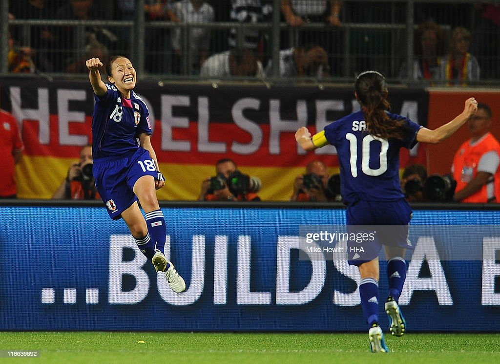 Karina Maruyama of Japan celebrates with team mate Homare Sawa after scoring the winning goal during the FIFA Women's World Cup 2011 Quarter Final match between Germany and Japan at Arena IM Allerpark on July 9, 2011 in Wolfsburg, Germany.