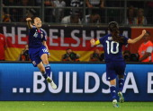 Karina Maruyama of Japan celebrates with team mate Homare Sawa after scoring the winning goal during the FIFA Women's World Cup 2011 Quarter Final...