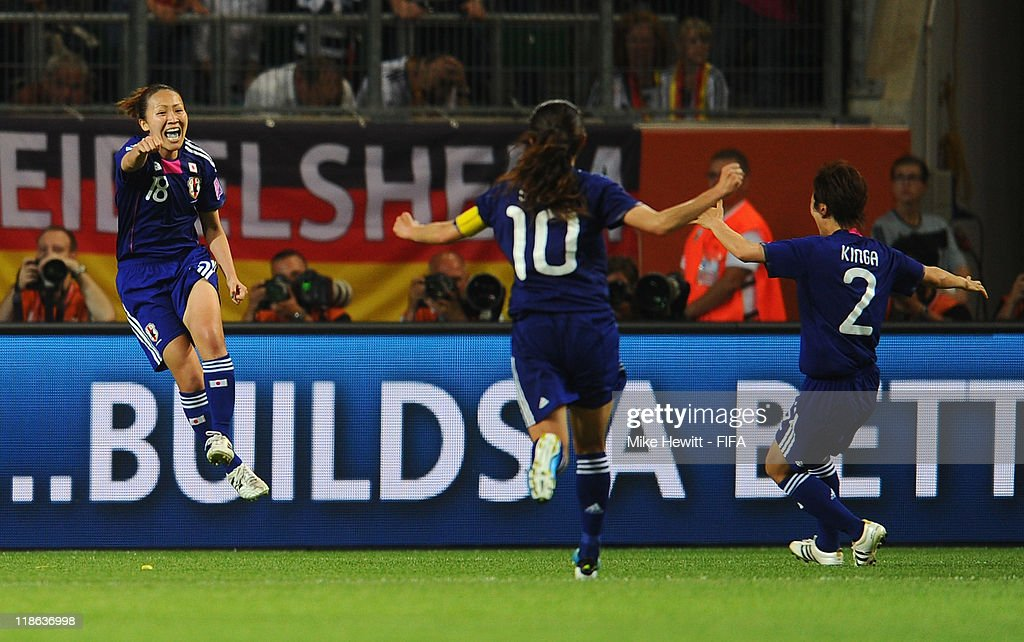 Karina Maruyama of Japan celebrates with team mates Homare Sawa and Yukari Kinga after scoring the winning goal during the FIFA Women's World Cup 2011 Quarter Final match between Germany and Japan at Arena IM Allerpark on July 9, 2011 in Wolfsburg, Germany.