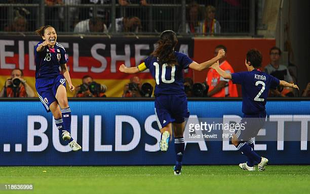 Karina Maruyama of Japan celebrates with team mates Homare Sawa and Yukari Kinga after scoring the winning goal during the FIFA Women's World Cup...