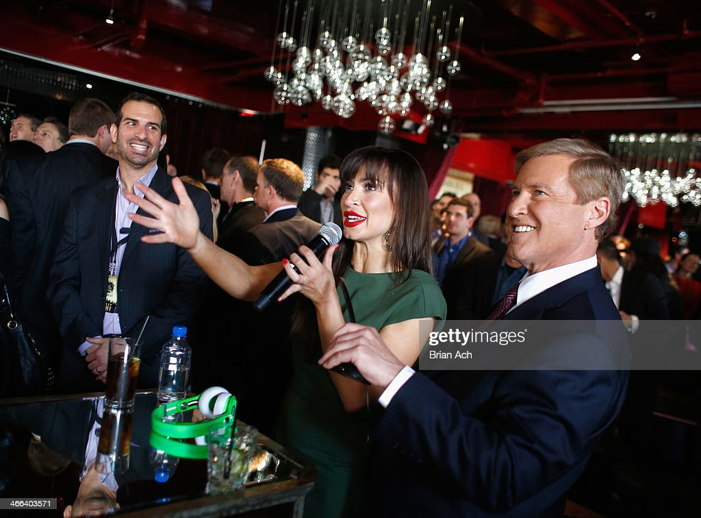 <a gi-track='captionPersonalityLinkClicked' href=/galleries/search?phrase=Karina+Smirnoff&family=editorial&specificpeople=4029232 ng-click='$event.stopPropagation()'>Karina Smirnoff</a> and <a gi-track='captionPersonalityLinkClicked' href=/galleries/search?phrase=Leigh+Steinberg&family=editorial&specificpeople=221448 ng-click='$event.stopPropagation()'>Leigh Steinberg</a> interact with military troops abroad via a live link during the 2014 <a gi-track='captionPersonalityLinkClicked' href=/galleries/search?phrase=Leigh+Steinberg&family=editorial&specificpeople=221448 ng-click='$event.stopPropagation()'>Leigh Steinberg</a> Super Bowl Party at 230 Fifth Avenue on February 1, 2014 in New York City.