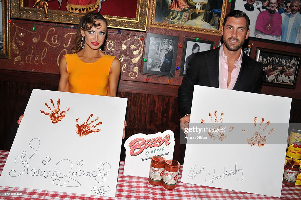 <a gi-track='captionPersonalityLinkClicked' href=/galleries/search?phrase=Karina+Smirnoff&family=editorial&specificpeople=4029232 ng-click='$event.stopPropagation()'>Karina Smirnoff</a> and Maks Chmerkovskiy celebrate their Opening Night with marinara handprints at Buca di Beppo Times Square followed by a party downstairs at Planet Hollywood Times Square on July 14, 2013 in New York City.