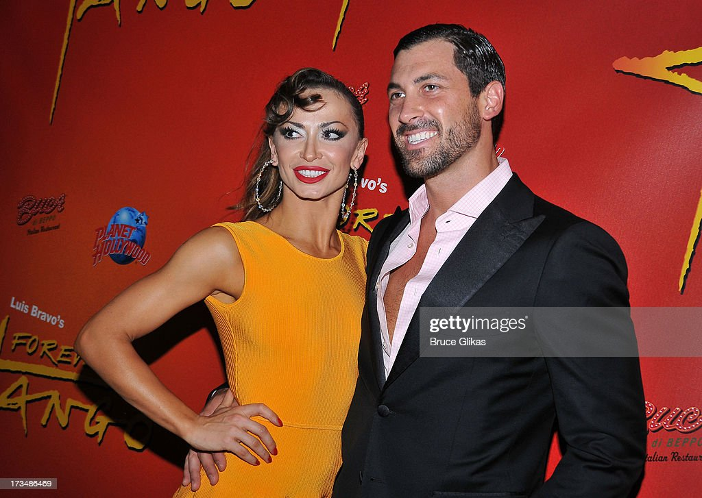 <a gi-track='captionPersonalityLinkClicked' href=/galleries/search?phrase=Karina+Smirnoff&family=editorial&specificpeople=4029232 ng-click='$event.stopPropagation()'>Karina Smirnoff</a> and Maks Chmerkovskiy pose at the 'Forever Tango' opening night party at Planet Hollywood Times Square on July 14, 2013 in New York City.