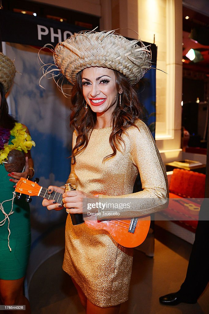 <a gi-track='captionPersonalityLinkClicked' href=/galleries/search?phrase=Karina+Smirnoff&family=editorial&specificpeople=4029232 ng-click='$event.stopPropagation()'>Karina Smirnoff</a> celebrates POM Wonderful's launch of three new 100% Juice Blends by leading 125 people in setting the Guinness World Record for the longest beach-ball bounce in history at the Encore Beach Club at Wynn Las Vegas on August 29, 2013 in Las Vegas, Nevada.