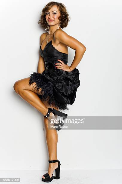 Karina Smirnoff is wearing a Black Halo dress and Dolce Gabbana heels