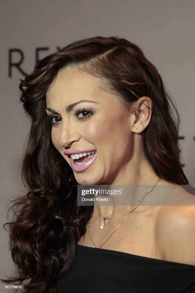 <a gi-track='captionPersonalityLinkClicked' href=/galleries/search?phrase=Karina+Smirnoff&family=editorial&specificpeople=4029232 ng-click='$event.stopPropagation()'>Karina Smirnoff</a> poses for photographs at her Valentine's Fan Meet And Greet at Revel Casino on February 15, 2013 in Atlantic City, New Jersey.