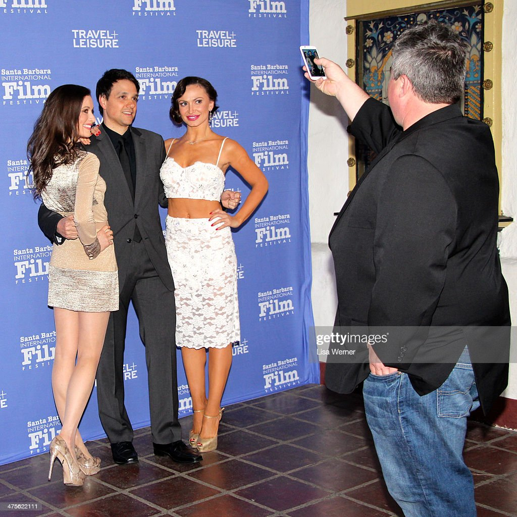 Karina Smirnoff (DWTS) updates her Facebook, Instagram and Twitter accounts while walking the red carpet at the Santa Barbara International Film Festival.