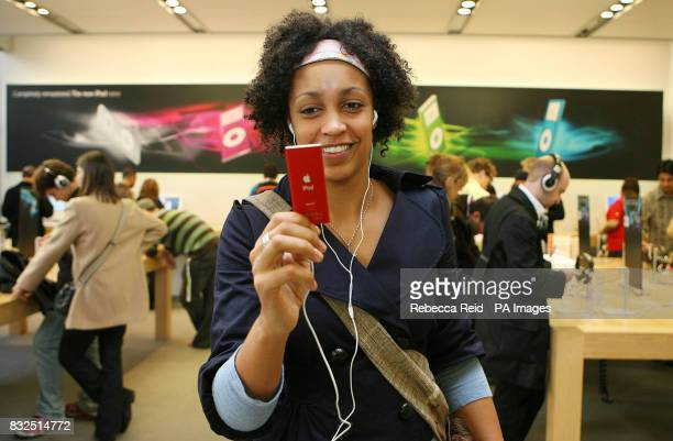 Karinda Mutabazi plays with Apple's new Red iPod Nano at the Apple Store on Regent Street in central London