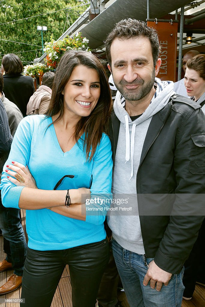 Karine Ferri and Humorist Mathieu Madenian attend Roland Garros Tennis French Open 2013 - Day 1 on May 26, 2013 in Paris, France.