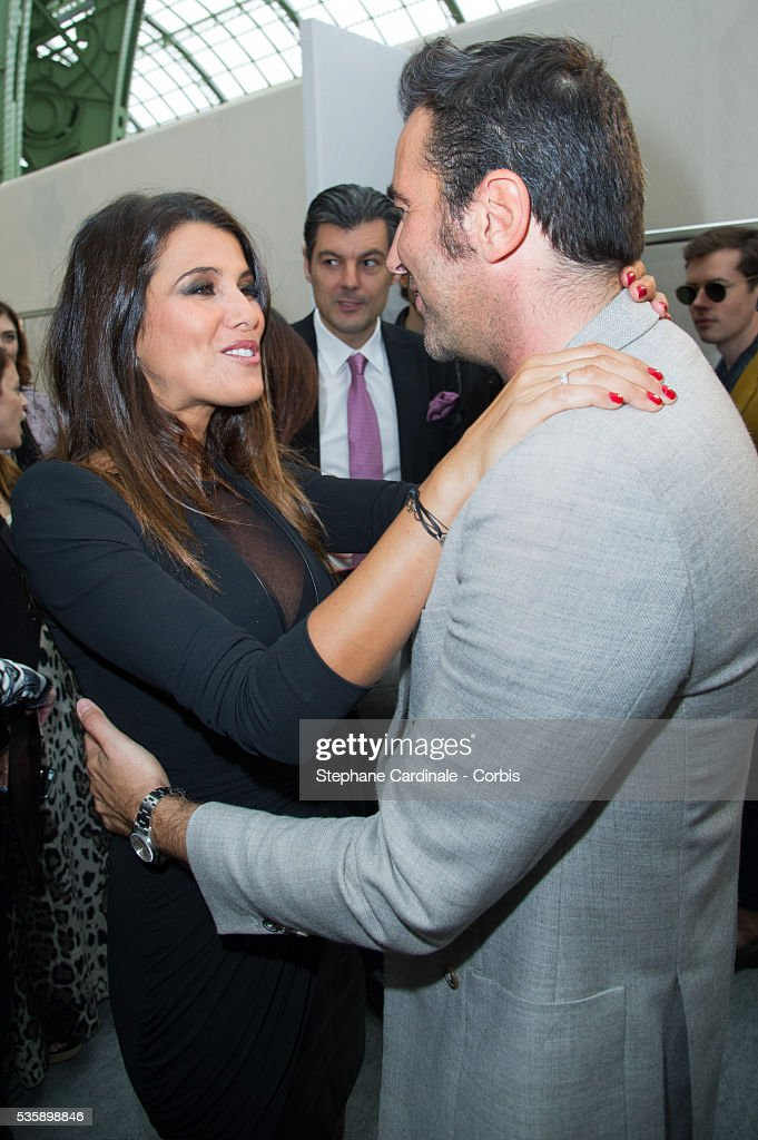 Karine Ferri and the stylist Raffaele Borriello attends Leonard show, as part of the Paris Fashion Week Womenswear Spring/Summer 2014, in Paris.