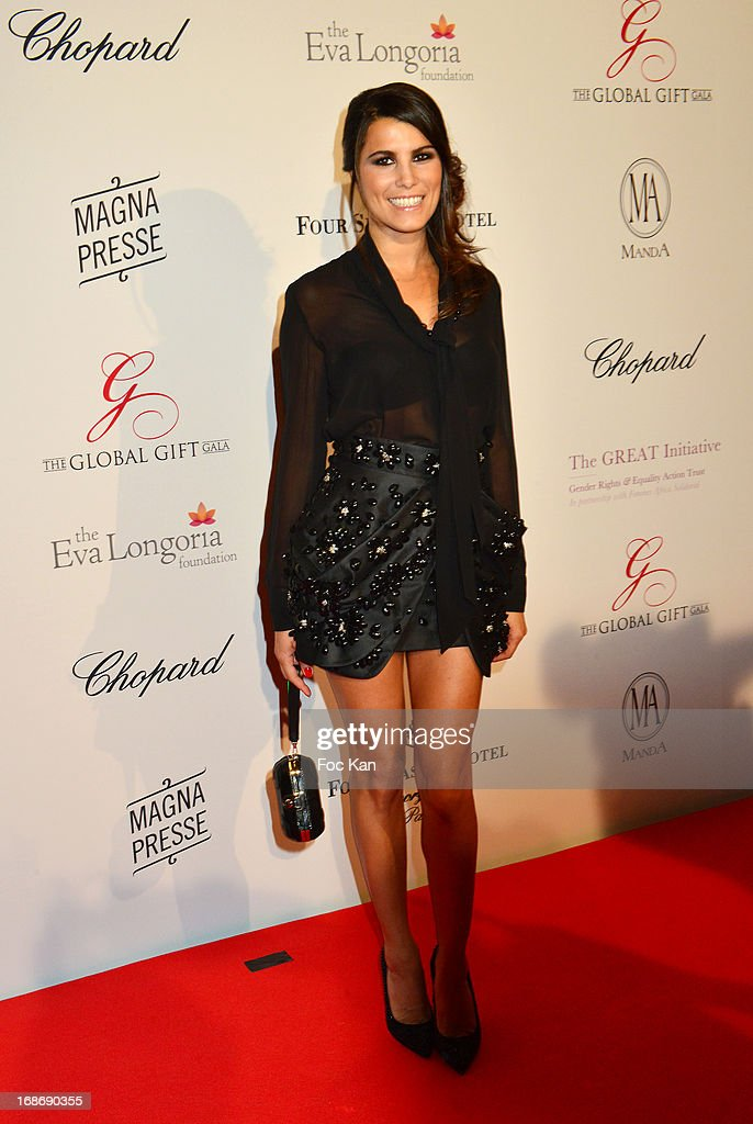 <a gi-track='captionPersonalityLinkClicked' href=/galleries/search?phrase=Karine+Ferri&family=editorial&specificpeople=4532443 ng-click='$event.stopPropagation()'>Karine Ferri</a> attends the Eva Longoria Presents 'Global Gift Gala' 2013 - Photocall at the Hotel Four Season GeorgesV on May 13, 2013 in Paris, France.