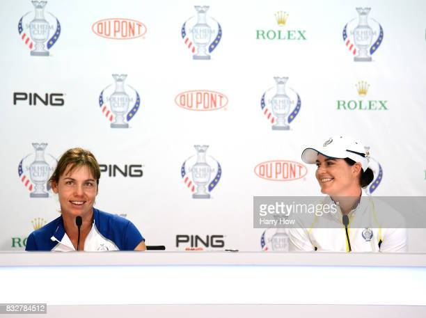 Karine Icher and Caroline Masson of Team Europe laugh answering a question during a press conference for the Solheim Cup at the Des Moines Golf and...