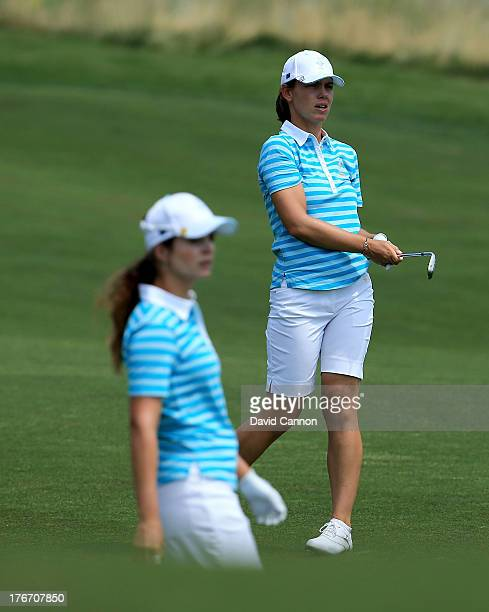 Karine Icher of France and the European Team watches her third shot on the first hole during the afternoon fourball matches as her partner Beatriz...