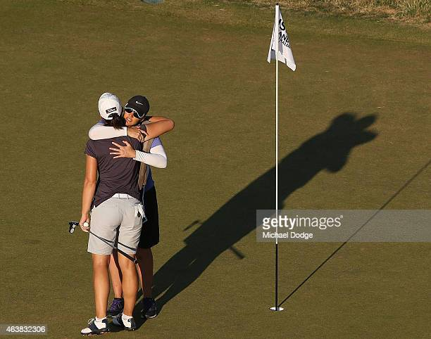 Karine Icher of France is hugged by her caddie after completing her round on the 18th hole during day one of the LPGA Australian Open at Royal...