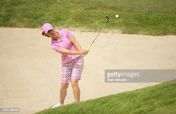 Karine Icher of France plays a bunker shot on the 15th hole during the first round of the HSBC Women's Champions at Sentosa Golf Club on February 27...