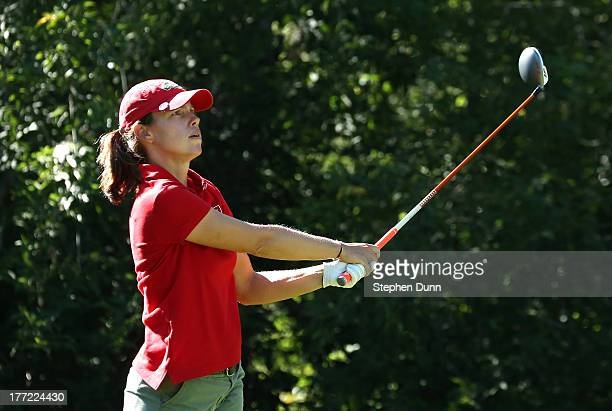 Karine Icher of France watches her tee shot on the fifth hole during the CN Canadian Women's Open at Royal Mayfair Golf Club on August 22 2013 in...