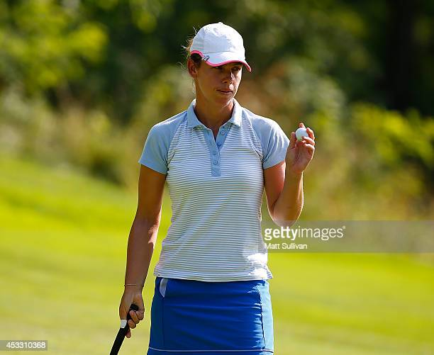 Karine Icher of France waves to the gallery after making a birdie on the seventh hole during the first round of the Meijer LPGA Classic at...