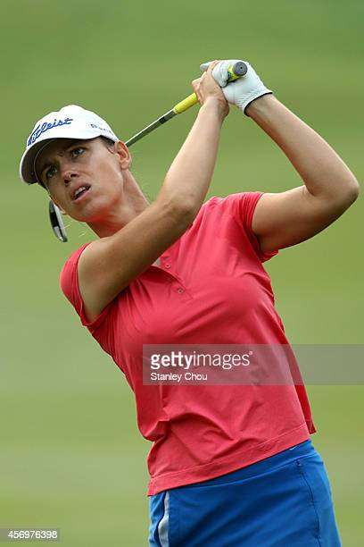 Karine Icher of Frnace watches her tee shot on the 10th hole during the Sime Darby LPGA at Kuala Lumpur Golf Country Club on October 9 2014 in Kuala...