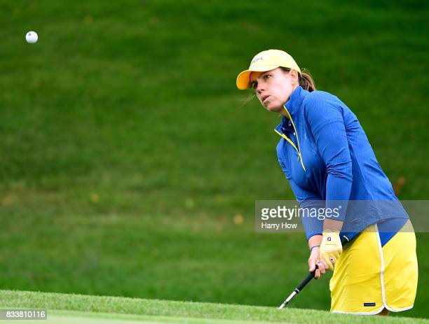 Karine Icher of Team Europe hits out of the rough on the 17th hole during practice for the Solheim Cup at the Des Moines Golf and Country Club on...