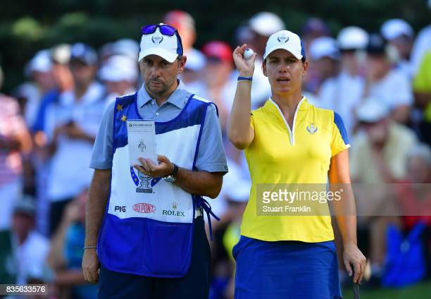 Karine Icher of Team Europe lines up a putt during the second day afternoon fourball matches of The Solheim Cup at Des Moines Golf and Country Club...